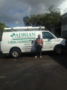 Joel In front of irrigation van